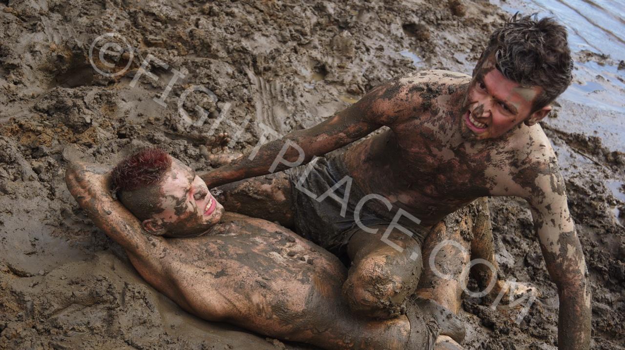 Male nude mud wrestling